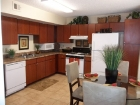 Santa Fe Oaks Apartments Eat-in Kitchen with Cherry Cabinetry